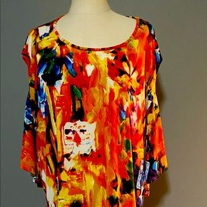 Woman's gently worn cold shoulder tunic.
